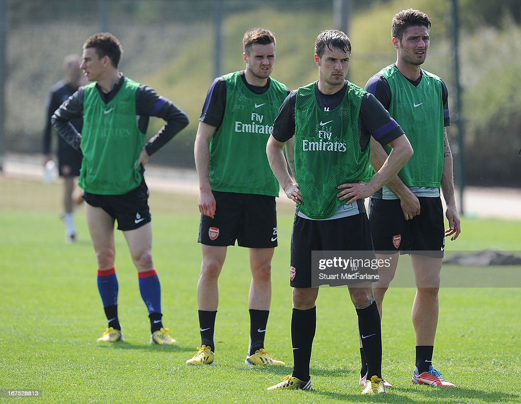 Carl Jenkinson, Aaron Ramsey and Olicier Giroud of Arsenal during a training session at London Colney on April 26, 2013 in St Albans, England.