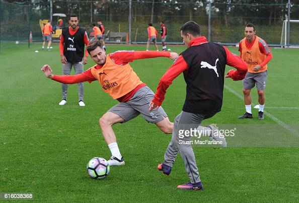 Carl Jenkinson and Alexis Sanchez of Arsenal during a training session at London Colney on October 21 2016 in St Albans England