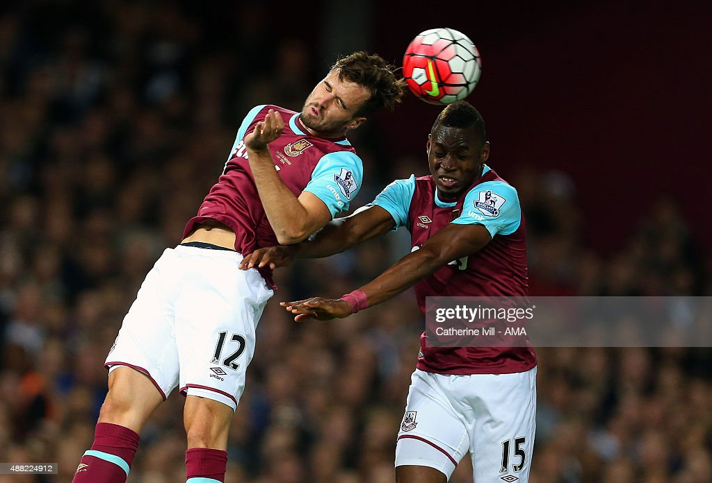 Carl Jenkinson and Diafra Sakho of West Ham United both head the ball during the Barclays Premier League match between West Ham United and Newcastle United on September 14, 2015 in London, United Kingdom.