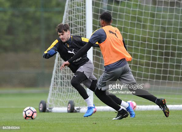 Carl Jenkinson and Jeff ReineAdelaide of Arsenal during a training session on February 19 2017 in St Albans England
