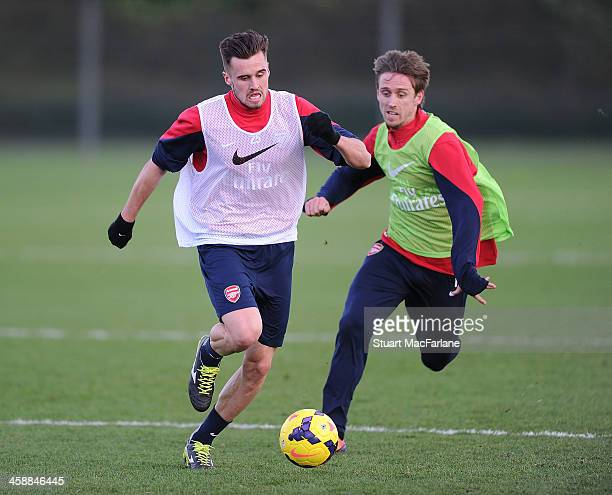 Carl Jenkinson and Nacho Monreal of Arsenal takes part in a training session at London Colney on December 22 2013 in St Albans England