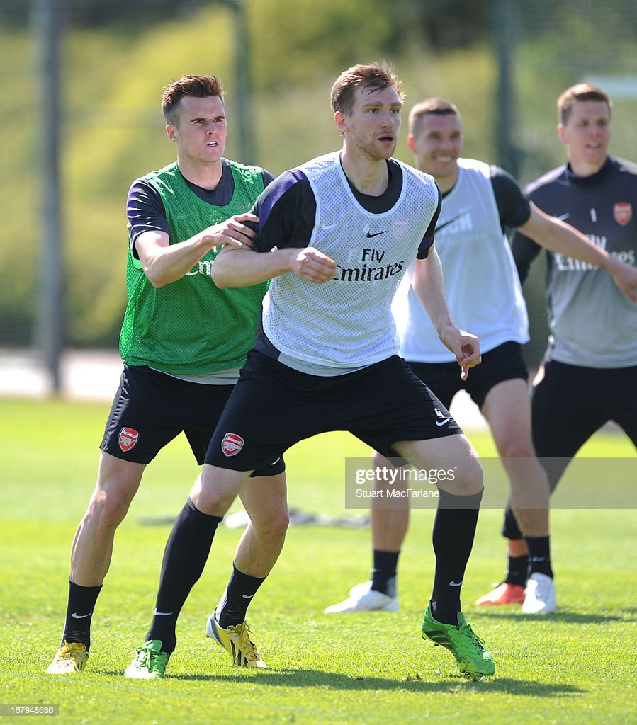 Carl Jenkinson and Per Mertesacker of Arsenal during a training session at London Colney on May 03, 2013 in St Albans, England.