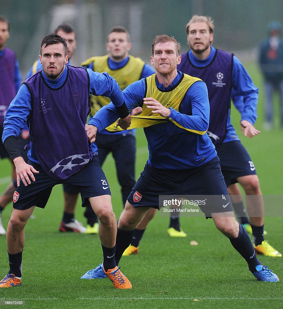Carl Jenkinson and Per Mertesacker of Arsenal during a training session at London Colney on October 21, 2013 in St Albans, England.