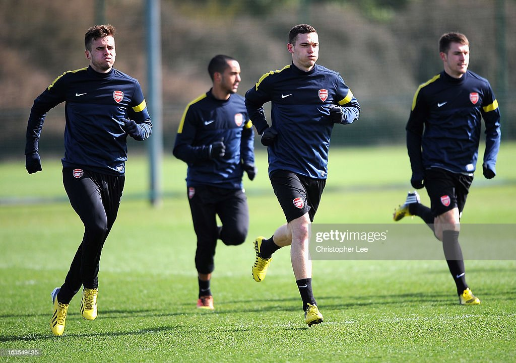Carl Jenkinson (L) and Thomas Vermaelen of Arsenal during a training session at London Colney on March 12, 2013 in St Albans, England.