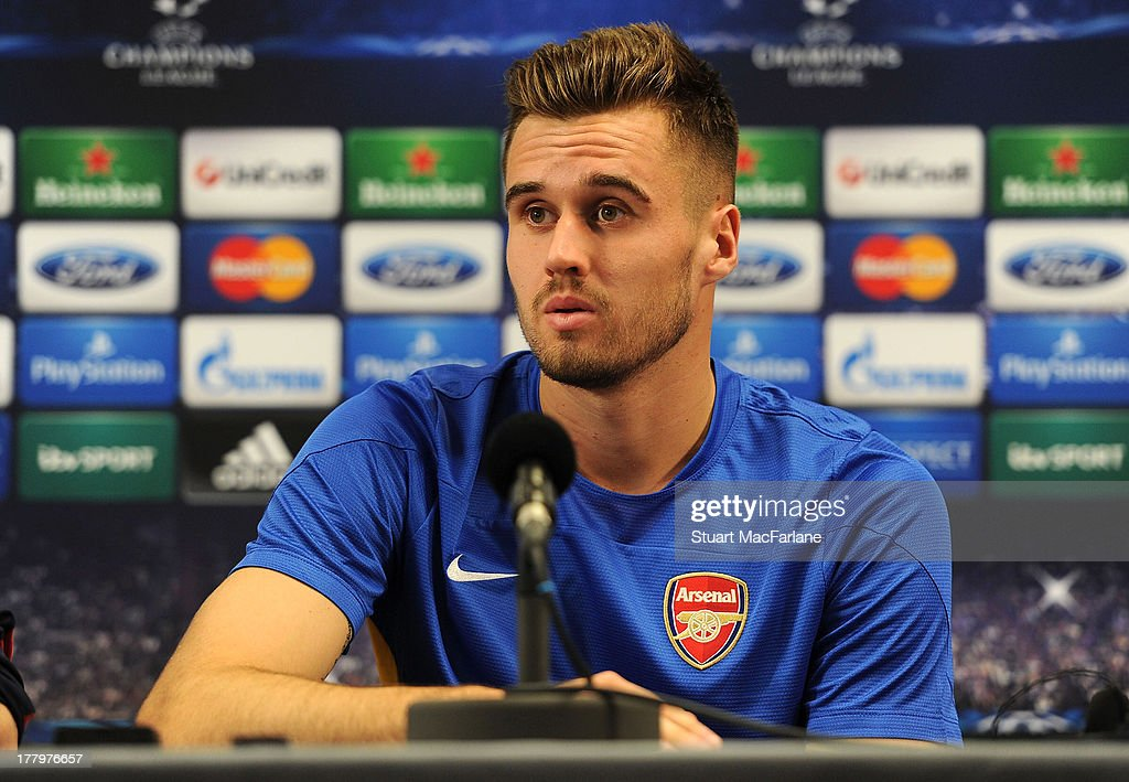 Carl Jenkinson of Arsenal attends a press conference ahead of their UEFA Champions League Play Off second leg match against Fenerbache at London Colney on August 26, 2013 in St Albans, England.