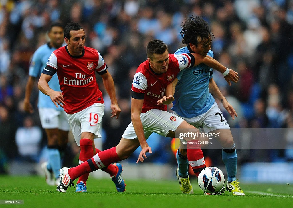 <a gi-track='captionPersonalityLinkClicked' href=/galleries/search?phrase=Carl+Jenkinson&family=editorial&specificpeople=7935131 ng-click='$event.stopPropagation()'>Carl Jenkinson</a> of Arsenal clashes with <a gi-track='captionPersonalityLinkClicked' href=/galleries/search?phrase=David+Silva&family=editorial&specificpeople=675795 ng-click='$event.stopPropagation()'>David Silva</a> of Manchester City during the Barclays Premier League match between Manchester City and Arsenal at Etihad Stadium on September 23, 2012 in Manchester, England.