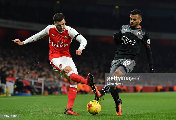 Carl Jenkinson of Arsenal crosses ahead of Sofiane Boufal of Southampton during the EFL Cup quarter final match between Arsenal and Southampton at...