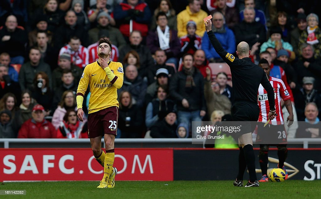 <a gi-track='captionPersonalityLinkClicked' href=/galleries/search?phrase=Carl+Jenkinson&family=editorial&specificpeople=7935131 ng-click='$event.stopPropagation()'>Carl Jenkinson</a> of Arsenal is shown the red card by the referee Mr A. Taylor during the Barclays Premier League match between Sunderland and Arsenal at the Stadium of Light on February 9, 2013 in Sunderland, England.