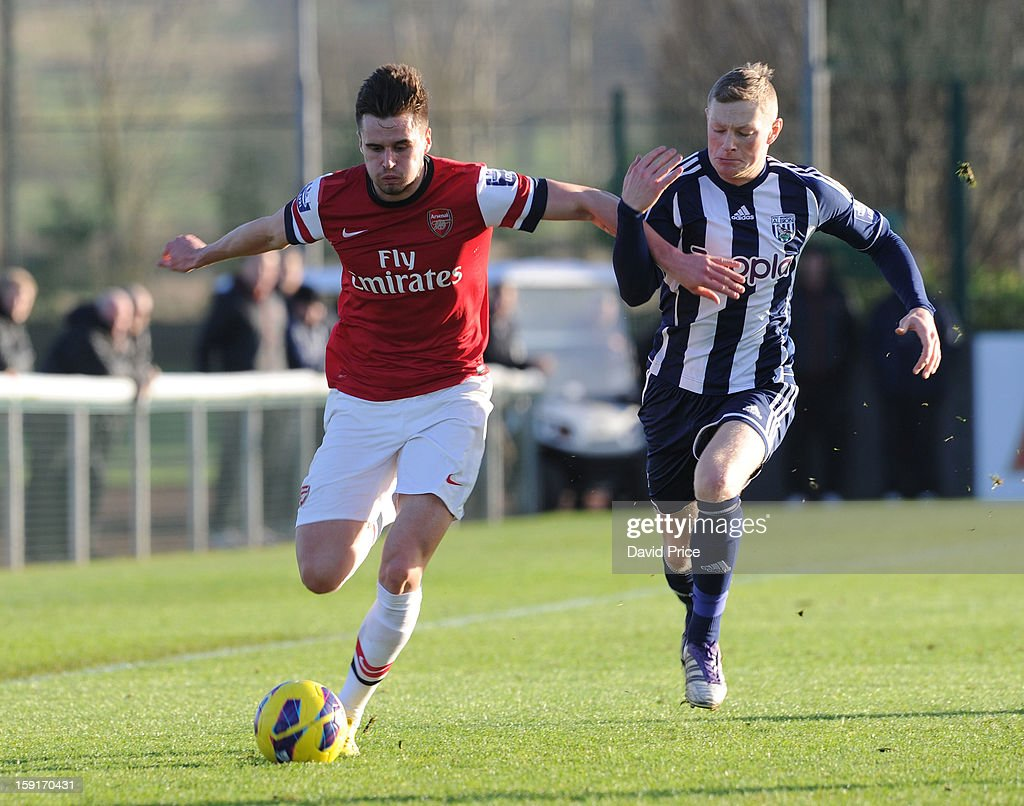 Carl Jenkinson of Arsenal shields the ball from Sam Mantom of WBA during the Barclays Premier U21 match between Arsenal U21 and West Bromwich Albion U21 at London Colney on January 9, 2013 in St Albans, United Kingdom.