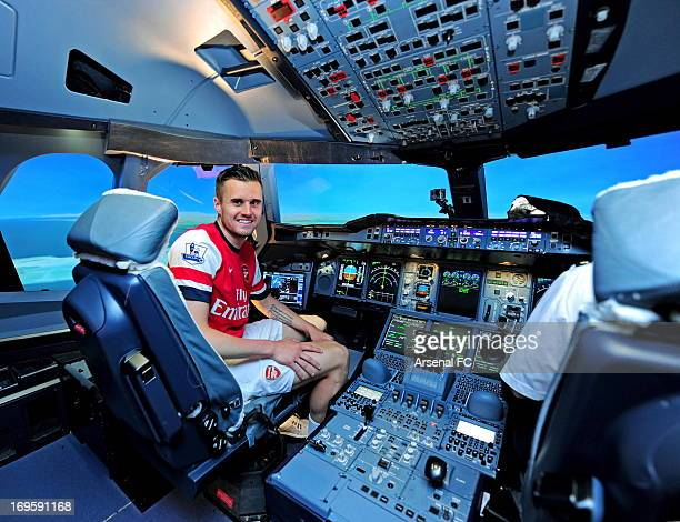 Carl Jenkinson of Arsenal sits in an Airline Simulator during the Arsenal Emirates Airline Simulator Challenge at Dubai International on May 21 2013...