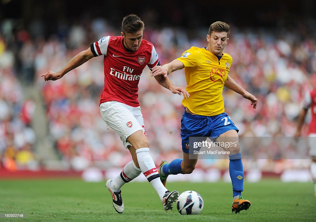Carl Jenkinson of Arsenal takes on Adam Lallana of Southampton during the Barclays Premier League match between Arsenal and Southampton at Emirates Stadium on September 15, 2012 in London, England.