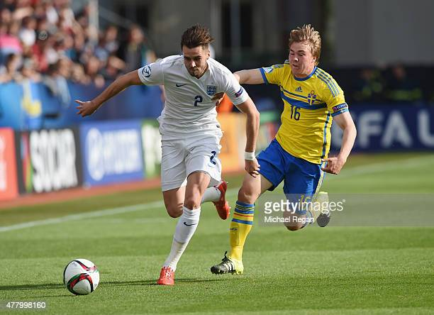Carl Jenkinson of England battles Simon Tibbling of Sweden during the UEFA Under21 European Championship 2015 match between Sweden and England at...