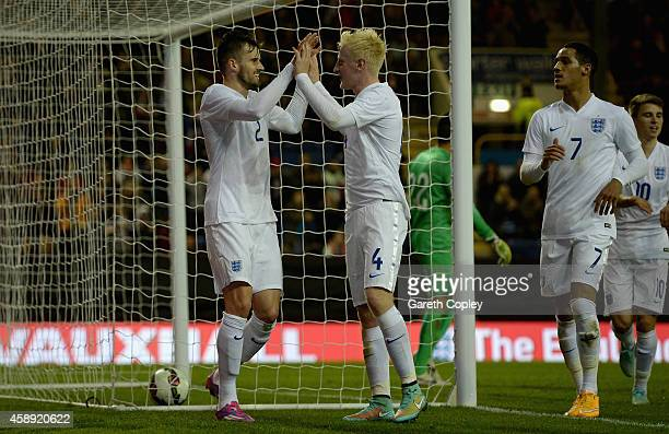Carl Jenkinson of England celebrates scoring his team's second goal with Will Hughes during the U21 International Friendly match between England and...