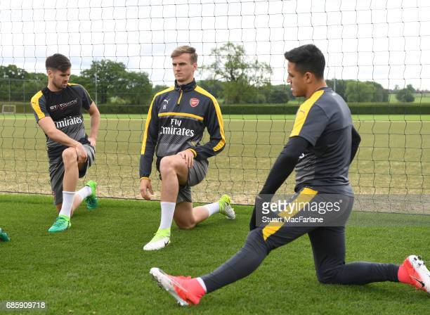 Carl Jenkinson Rob Holding and Alexis Sanchez of Arsenal during a training session at London Colney on May 20 2017 in St Albans England