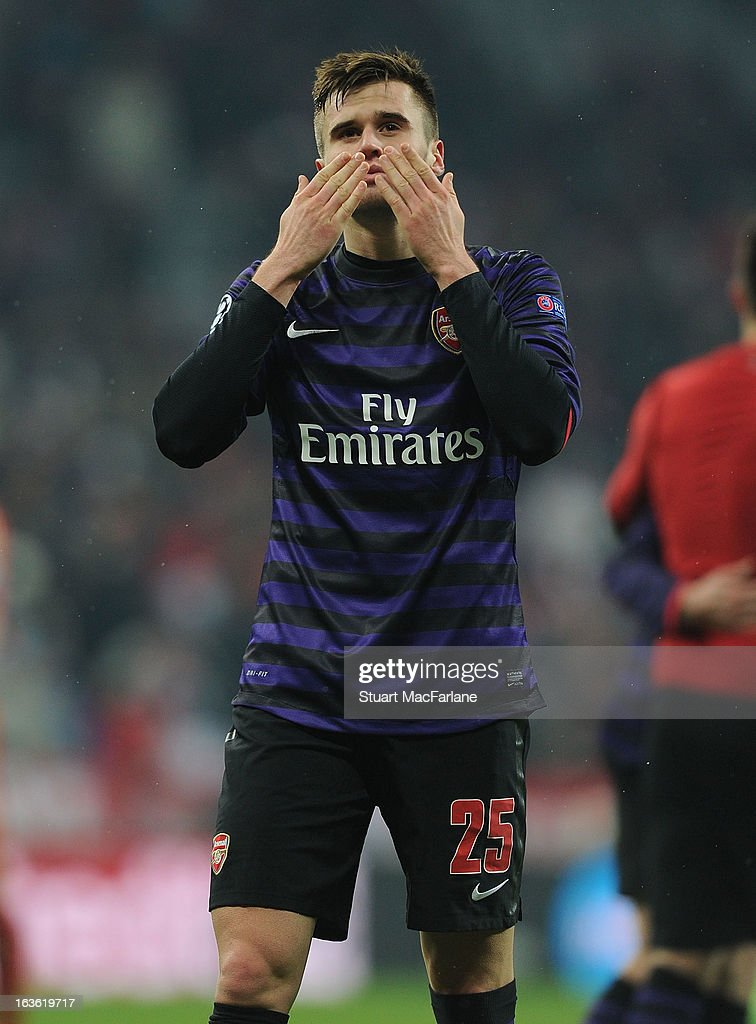 Carl Jenkinson salutes the Arsenal fans after the UEFA Champions League Round of 16 second leg match between Bayern Muenchen and Arsenal FC at Allianz Arena on March 13, 2013 in Munich, Germany.