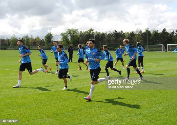 Carl Jenkinson Santi Cazorla and Mikel Arteta of Arsenal during a training session at London Colney on April 27 2014 in St Albans England
