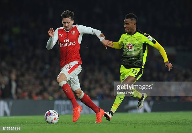 Carl Jenkison of Arsenal takes on Sandro Wieser of Reading during the match between Arsenal and Reading at Emirates Stadium on October 25 2016 in...