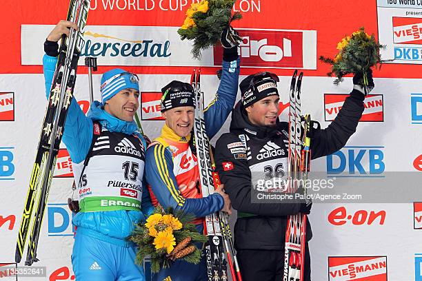Carl Johan Bergman of Sweden takes 1st place Andrei Makoveev of Russia takes 2nd place Benjamin Weger of Switzerland takes 3rd place during the IBU...