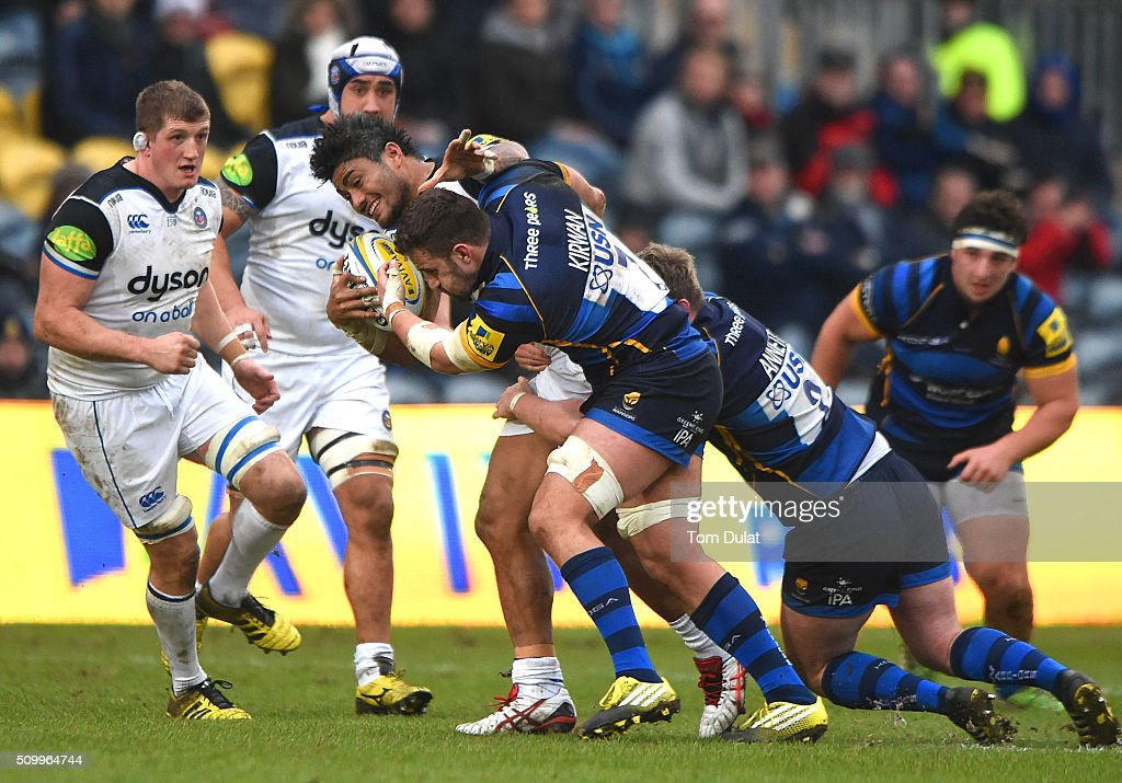 Carl Kirwan of Worcester Warriors tackles <a gi-track='captionPersonalityLinkClicked' href=/galleries/search?phrase=Amanaki+Mafi&family=editorial&specificpeople=15024452 ng-click='$event.stopPropagation()'>Amanaki Mafi</a> of Bath Rugby during the Aviva Premiership match between Worcester Warriors and Bath Rugby at Sixways Stadium on February 13, 2016 in Worcester, England. (Photo by Tom Dulat/Getty Images).