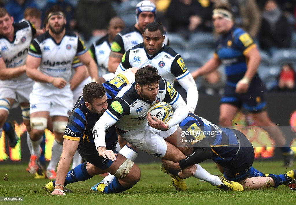 Carl Kirwan of Worcester Warriors tackles <a gi-track='captionPersonalityLinkClicked' href=/galleries/search?phrase=Matt+Banahan&family=editorial&specificpeople=2156682 ng-click='$event.stopPropagation()'>Matt Banahan</a> of Bath Rugby during the Aviva Premiership match between Worcester Warriors and Bath Rugby at Sixways Stadium on February 13, 2016 in Worcester, England. (Photo by Tom Dulat/Getty Images).