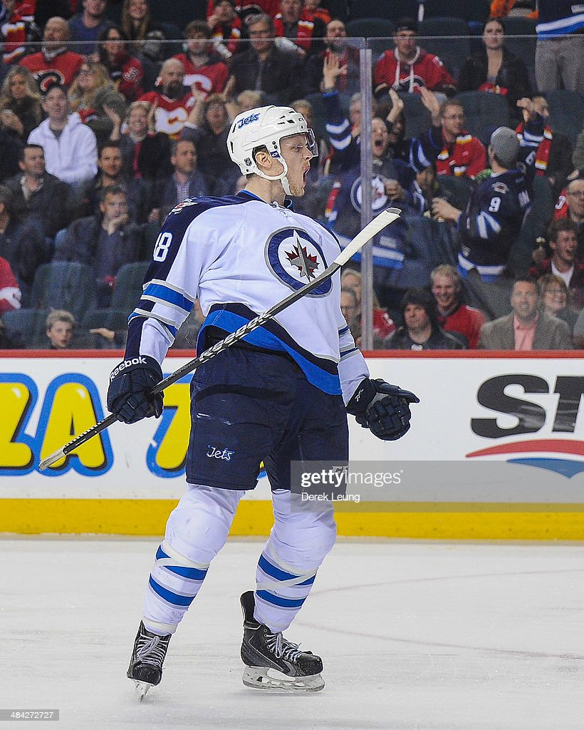 Carl Klingberg #48 of the Winnipeg Jets celebrates after scoring against the Calgary Flames during an NHL game at Scotiabank Saddledome on April 11, 2014 in Calgary, Alberta, Canada.