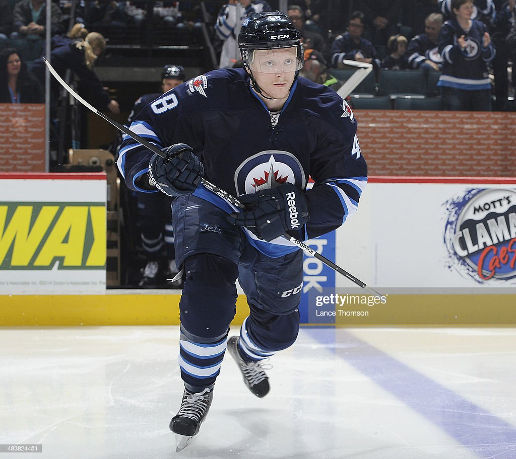 Carl Klingberg #48 of the Winnipeg Jets hits the ice prior to puck drop against the Minnesota Wild at the MTS Centre on April 7, 2014 in Winnipeg, Manitoba, Canada.