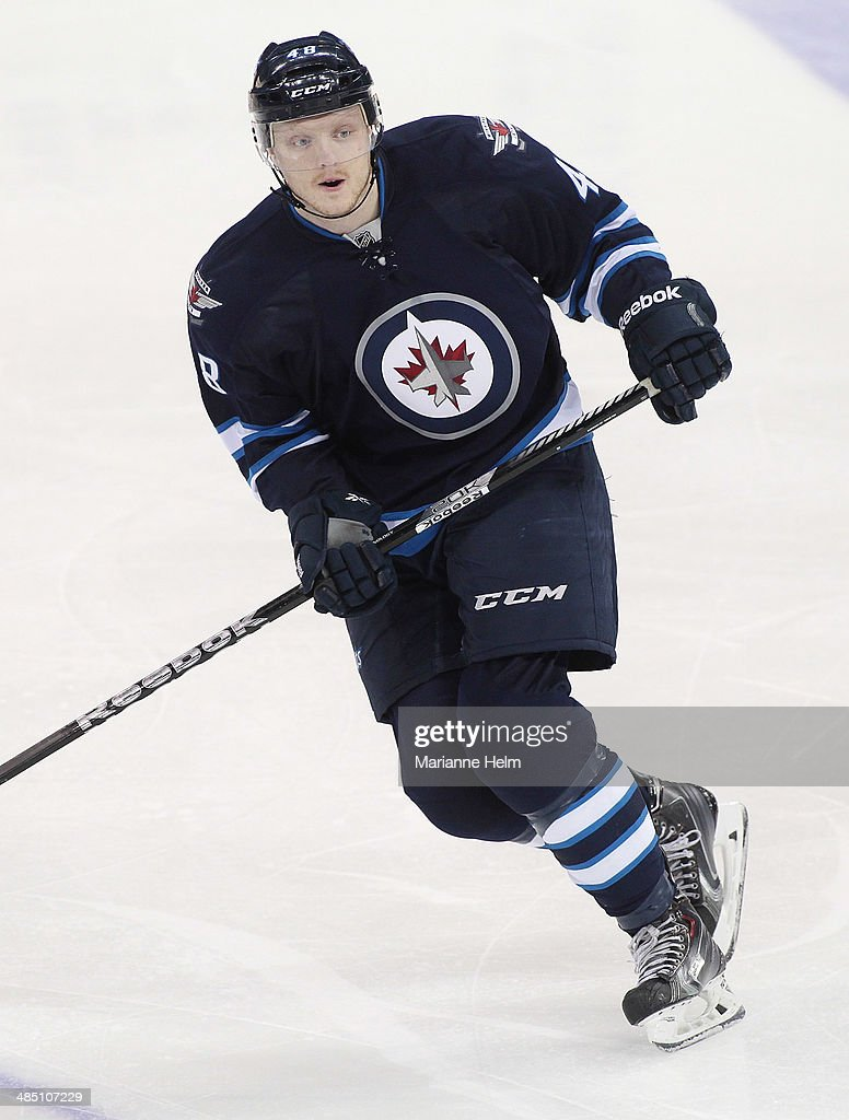 Carl Klingberg #48 of the Winnipeg Jets skates down the ice during the third period of the NHL game against the Boston Bruins at the MTS Centre on April 10, 2014 in Winnipeg, Manitoba, Canada.