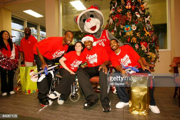 Carl Landry Joey Dorsey and Luther Head with the Rockets Mascot Clutch of the Houston Rockets pose as they pass out gifts to the kids at The Ronald...