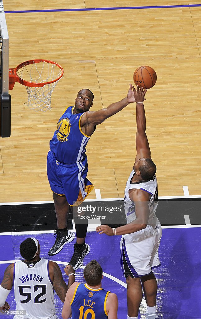 Carl Landry #7 of the Golden State Warriors and Chuck Hayes #42 of the Sacramento Kings go after the rebound on October 17, 2012 at Power Balance Pavilion in Sacramento, California.