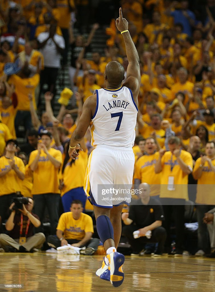 <a gi-track='captionPersonalityLinkClicked' href=/galleries/search?phrase=Carl+Landry&family=editorial&specificpeople=4111952 ng-click='$event.stopPropagation()'>Carl Landry</a> #7 of the Golden State Warriors celebrates against the San Antonio Spurs in Game Four of the Western Conference Semifinals during the 2013 NBA Playoffs on May 12, 2013 at the Oracle Arena in Oakland, California.