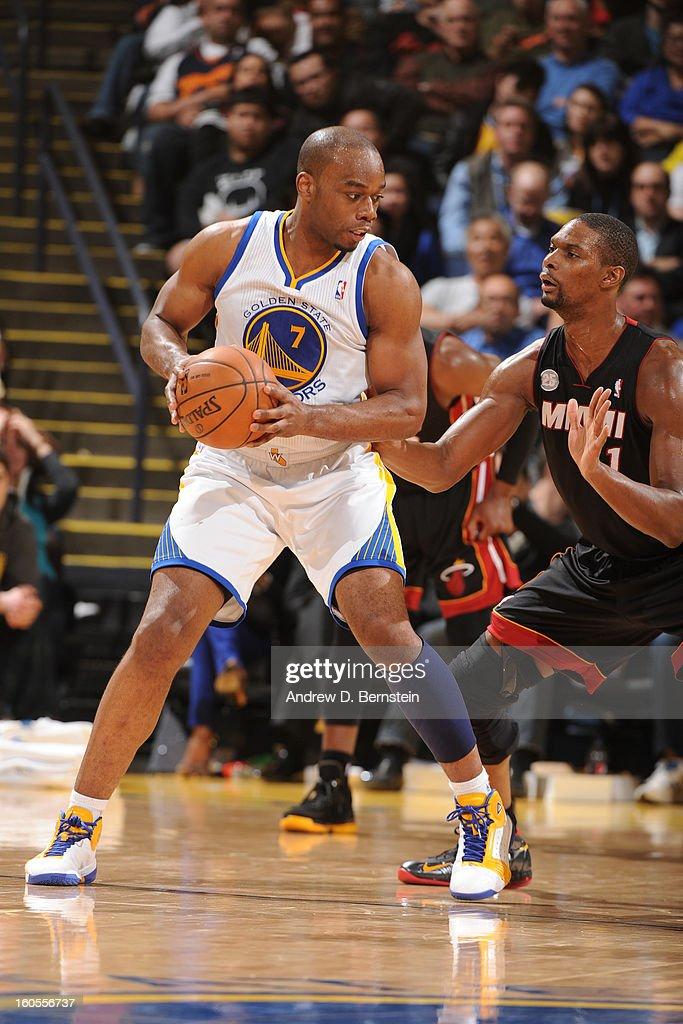 Carl Landry #7 of the Golden State Warriors controls the ball against Chris Bosh #1 of the Miami Heat on January 16, 2013 at Oracle Arena in Oakland, California.