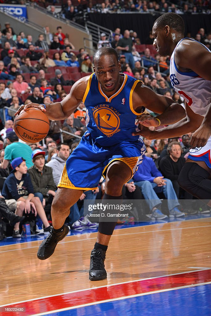 <a gi-track='captionPersonalityLinkClicked' href=/galleries/search?phrase=Carl+Landry&family=editorial&specificpeople=4111952 ng-click='$event.stopPropagation()'>Carl Landry</a> #7 of the Golden State Warriors drives to the basket against the Philadelphia 76ers on March 2, 2013 at the Wells Fargo Center in Philadelphia, Pennsylvania.