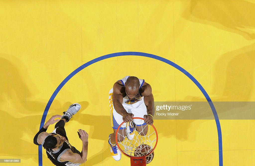 Carl Landry #7 of the Golden State Warriors dunks against Danny Green #4 of the San Antonio Spurs in Game Six of the Western Conference Semifinals during the 2013 NBA Playoffs on May 16, 2013 at Oracle Arena in Oakland, California.