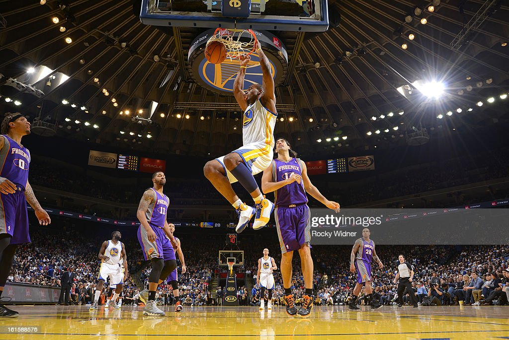 <a gi-track='captionPersonalityLinkClicked' href=/galleries/search?phrase=Carl+Landry&family=editorial&specificpeople=4111952 ng-click='$event.stopPropagation()'>Carl Landry</a> #7 of the Golden State Warriors dunks against <a gi-track='captionPersonalityLinkClicked' href=/galleries/search?phrase=Luis+Scola&family=editorial&specificpeople=2464749 ng-click='$event.stopPropagation()'>Luis Scola</a> #14 of the Phoenix Suns on February 2, 2013 at Oracle Arena in Oakland, California.