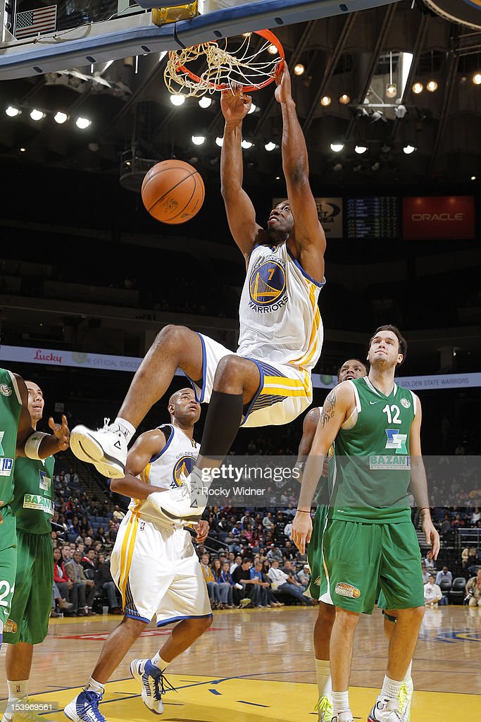 <a gi-track='captionPersonalityLinkClicked' href=/galleries/search?phrase=Carl+Landry&family=editorial&specificpeople=4111952 ng-click='$event.stopPropagation()'>Carl Landry</a> #7 of the Golden State Warriors dunks against the Maccabi Haifa on October 11, 2012 at Oracle Arena in Oakland, California.