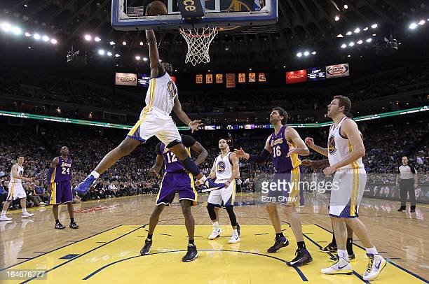 Carl Landry of the Golden State Warriors dunks the ball against the Los Angeles Lakers at Oracle Arena on March 25 2013 in Oakland California NOTE TO...