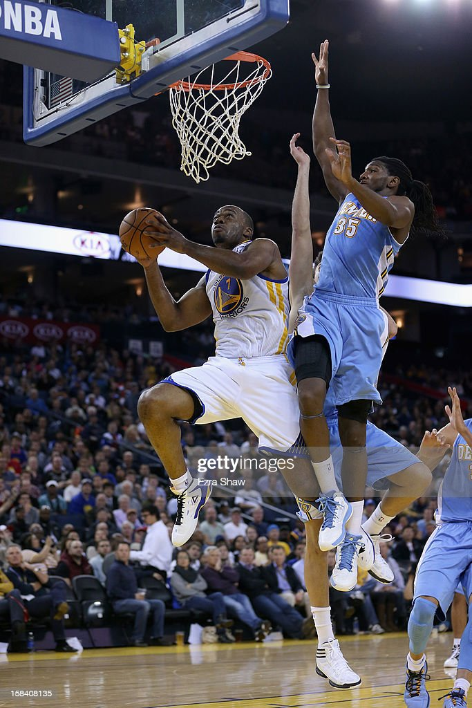 <a gi-track='captionPersonalityLinkClicked' href=/galleries/search?phrase=Carl+Landry&family=editorial&specificpeople=4111952 ng-click='$event.stopPropagation()'>Carl Landry</a> #7 of the Golden State Warriors gets past <a gi-track='captionPersonalityLinkClicked' href=/galleries/search?phrase=Kenneth+Faried&family=editorial&specificpeople=5765135 ng-click='$event.stopPropagation()'>Kenneth Faried</a> #35 of the Denver Nuggets at Oracle Arena on November 29, 2012 in Oakland, California.