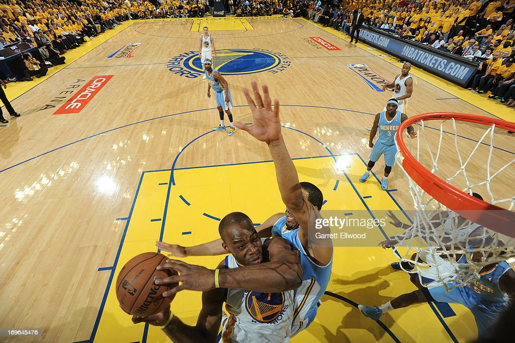 <a gi-track='captionPersonalityLinkClicked' href=/galleries/search?phrase=Carl+Landry&family=editorial&specificpeople=4111952 ng-click='$event.stopPropagation()'>Carl Landry</a> #7 of the Golden State Warriors goes to the basket against <a gi-track='captionPersonalityLinkClicked' href=/galleries/search?phrase=Andre+Miller&family=editorial&specificpeople=201678 ng-click='$event.stopPropagation()'>Andre Miller</a> #24 of the Denver Nuggets in Game Three of the Western Conference Quarterfinals during the 2013 NBA Playoffs on April 26, 2013 at the Oracle Arena in Oakland, California.
