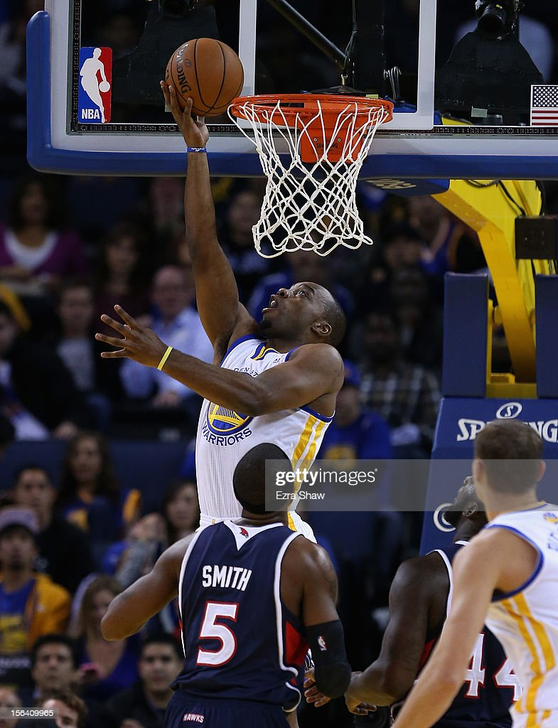 Carl Landry #7 of the Golden State Warriors goes up for a shot over Josh Smith #5 of the Atlanta Hawks at Oracle Arena on November 14, 2012 in Oakland, California.