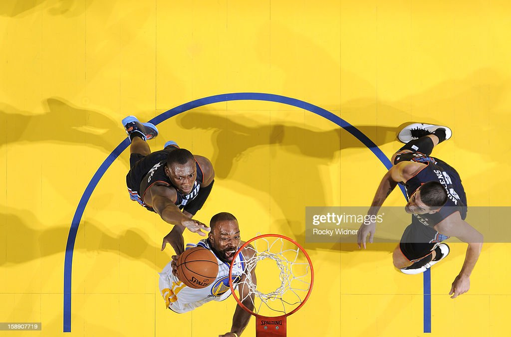 Carl Landry #7 of the Golden State Warriors goes up for the shot against Bismack Biyombo #0 of the Charlotte Bobcats on December 21, 2012 at Oracle Arena in Oakland, California.