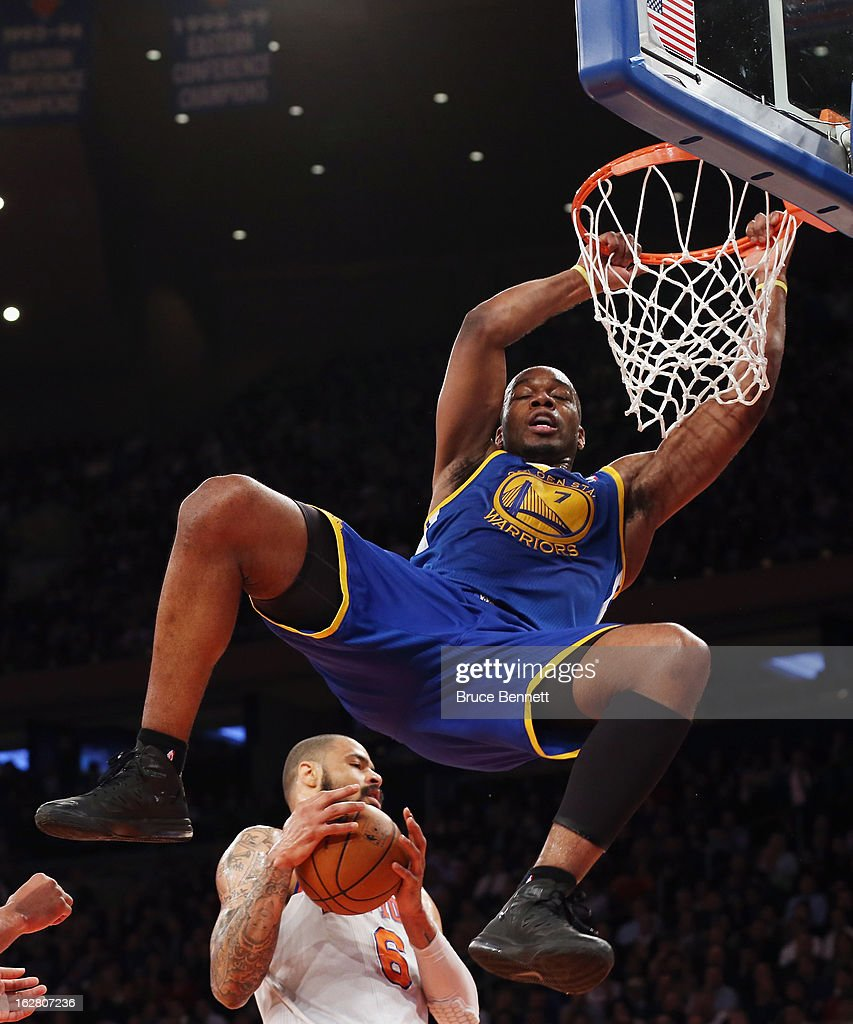 Carl Landry #7 of the Golden State Warriors hangs on the rim after missing two in the second quarter against the New York Knicks at Madison Square Garden on February 27, 2013 in New York City.