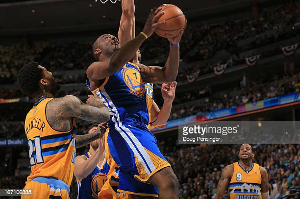 Carl Landry of the Golden State Warriors puts up a shot against Wilson Chandler of the Denver Nuggets during Game One of the Western Conference...
