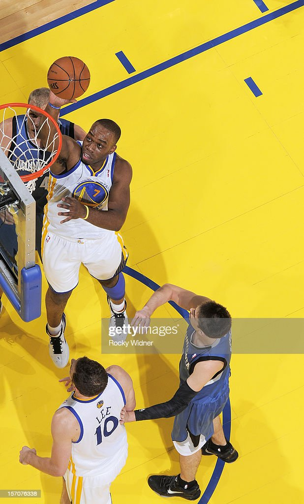 <a gi-track='captionPersonalityLinkClicked' href=/galleries/search?phrase=Carl+Landry&family=editorial&specificpeople=4111952 ng-click='$event.stopPropagation()'>Carl Landry</a> #7 of the Golden State Warriors puts up a shot against the Minnesota Timberwolves on November 24, 2012 at Oracle Arena in Oakland, California.