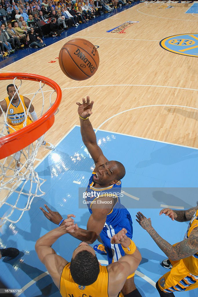 <a gi-track='captionPersonalityLinkClicked' href=/galleries/search?phrase=Carl+Landry&family=editorial&specificpeople=4111952 ng-click='$event.stopPropagation()'>Carl Landry</a> #7 of the Golden State Warriors puts up a shot against the Denver Nuggets in Game One of the Western Conference Quarter Finals during the 2013 NBA Playoffs on April 20, 2013 at the Pepsi Center in Denver, Colorado.