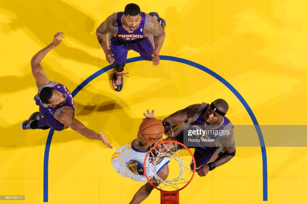 <a gi-track='captionPersonalityLinkClicked' href=/galleries/search?phrase=Carl+Landry&family=editorial&specificpeople=4111952 ng-click='$event.stopPropagation()'>Carl Landry</a> #7 of the Golden State Warriors rebounds against <a gi-track='captionPersonalityLinkClicked' href=/galleries/search?phrase=Jermaine+O%27Neal&family=editorial&specificpeople=201524 ng-click='$event.stopPropagation()'>Jermaine O'Neal</a> #20 of the Phoenix Suns on February 20, 2013 at Oracle Arena in Oakland, California.