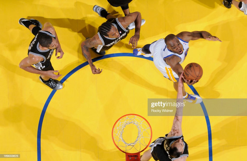 Carl Landry #7 of the Golden State Warriors rebounds against Manu Ginobili #20 of the San Antonio Spurs in Game Four of the Western Conference Semifinals during the 2013 NBA Playoffs on May 12, 2013 at Oracle Arena in Oakland, California.