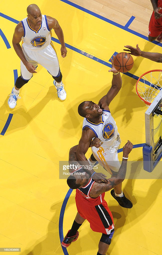 <a gi-track='captionPersonalityLinkClicked' href=/galleries/search?phrase=Carl+Landry&family=editorial&specificpeople=4111952 ng-click='$event.stopPropagation()'>Carl Landry</a> #7 of the Golden State Warriors rebounds against the Washington Wizards on March 23, 2013 at Oracle Arena in Oakland, California.