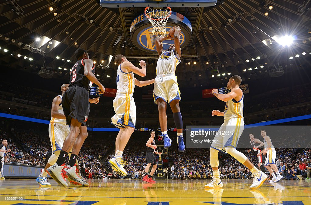 <a gi-track='captionPersonalityLinkClicked' href=/galleries/search?phrase=Carl+Landry&family=editorial&specificpeople=4111952 ng-click='$event.stopPropagation()'>Carl Landry</a> #7 of the Golden State Warriors rebounds against the Portland Trail Blazers on March 30, 2013 at Oracle Arena in Oakland, California.