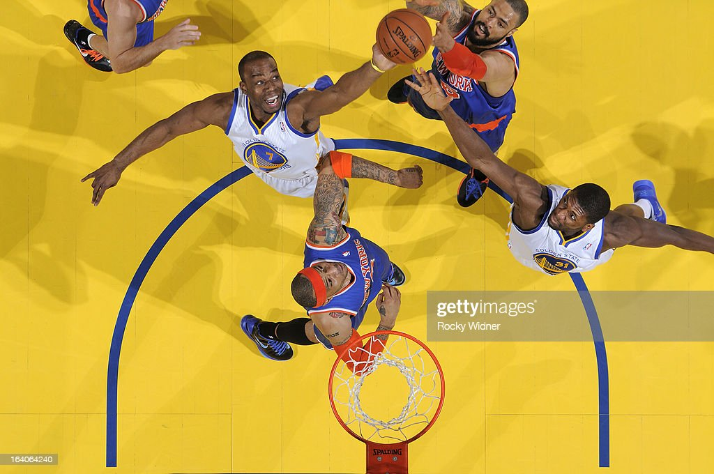 <a gi-track='captionPersonalityLinkClicked' href=/galleries/search?phrase=Carl+Landry&family=editorial&specificpeople=4111952 ng-click='$event.stopPropagation()'>Carl Landry</a> #7 of the Golden State Warriors rebounds against <a gi-track='captionPersonalityLinkClicked' href=/galleries/search?phrase=Tyson+Chandler&family=editorial&specificpeople=202061 ng-click='$event.stopPropagation()'>Tyson Chandler</a> #6 and <a gi-track='captionPersonalityLinkClicked' href=/galleries/search?phrase=Kenyon+Martin&family=editorial&specificpeople=201522 ng-click='$event.stopPropagation()'>Kenyon Martin</a> #3 of the New York Knicks on March 11, 2013 at Oracle Arena in Oakland, California.