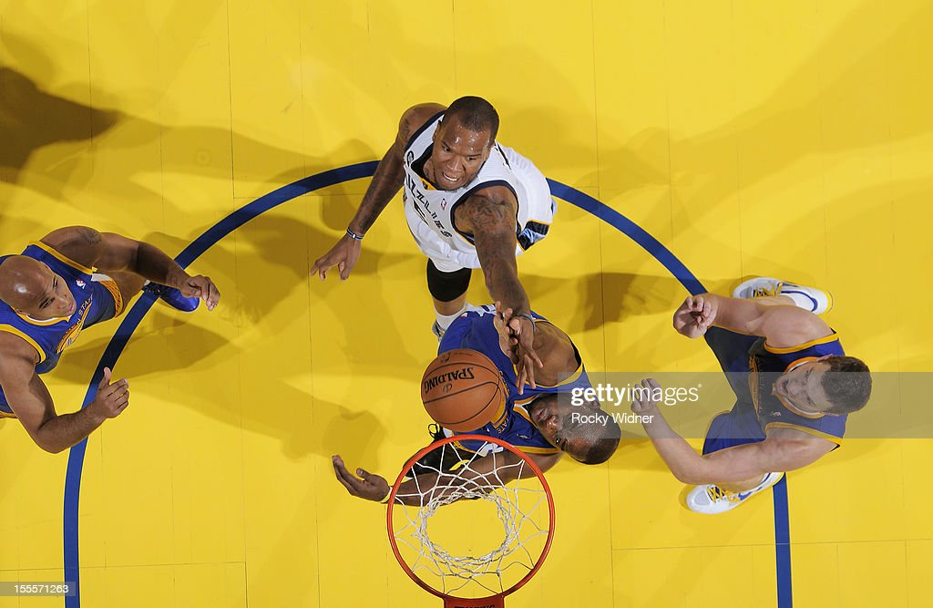 <a gi-track='captionPersonalityLinkClicked' href=/galleries/search?phrase=Carl+Landry&family=editorial&specificpeople=4111952 ng-click='$event.stopPropagation()'>Carl Landry</a> #7 of the Golden State Warriors rebounds the ball againts <a gi-track='captionPersonalityLinkClicked' href=/galleries/search?phrase=Marreese+Speights&family=editorial&specificpeople=4187263 ng-click='$event.stopPropagation()'>Marreese Speights</a> #5 of the Memphis Grizzlies on November 2, 2012 at Oracle Arena in Oakland, California.